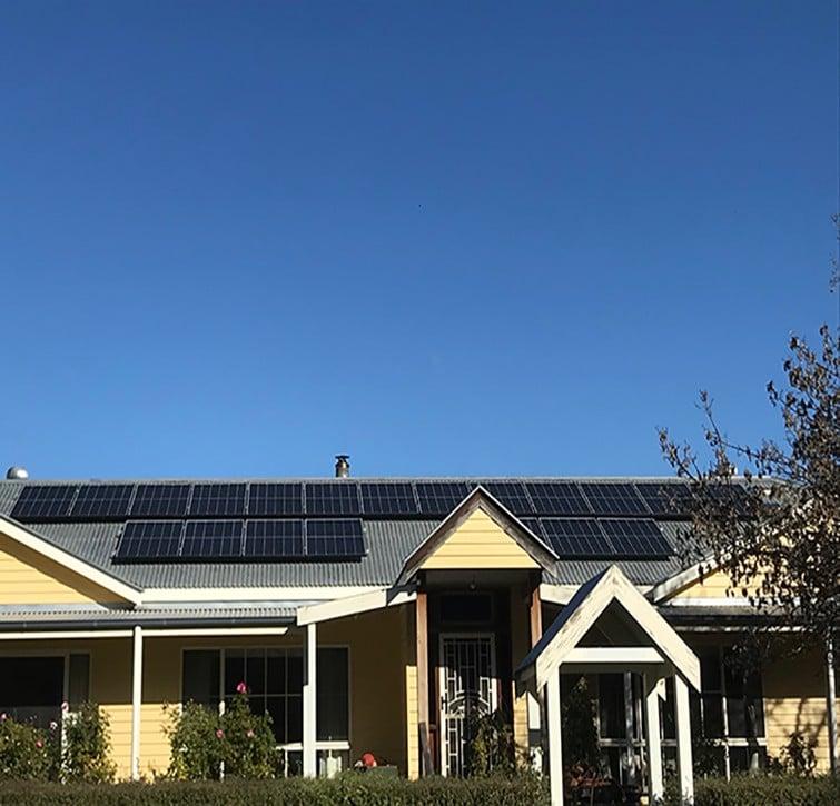 Solar panels on wooden house